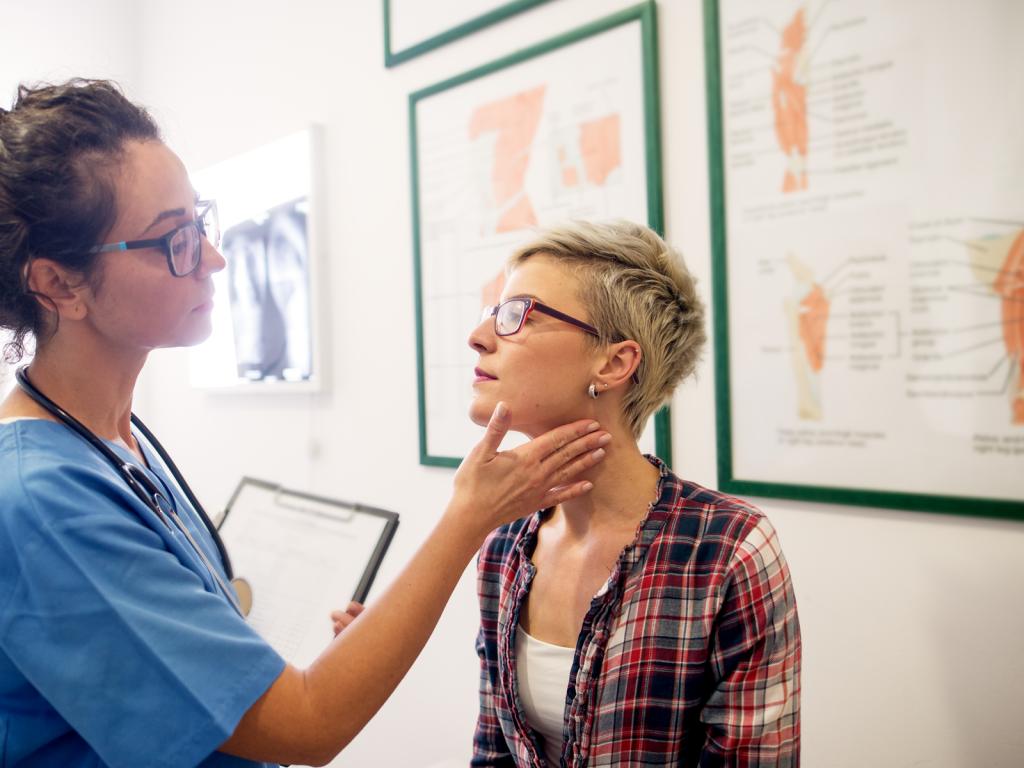 Nurse checking out a patient