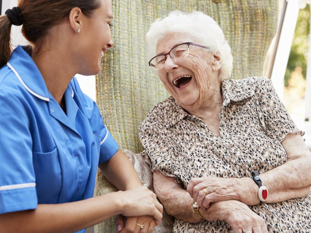 Nurse and Smiling Elderly Patient